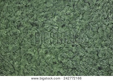 Wrinkled Crumpled Surface Texture. Abstract Dark Green Background