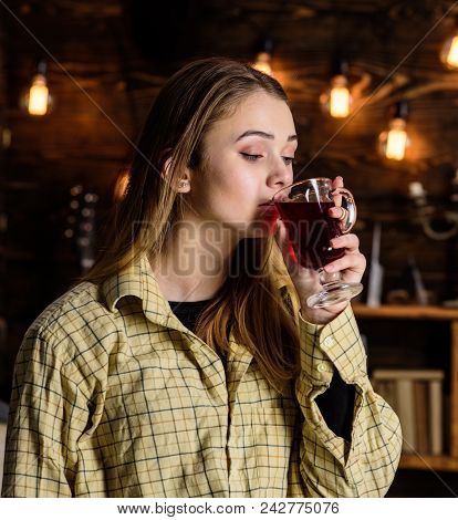 Lady Enjoy Mulled Wine In Warm Atmosphere, Wooden Interior. Girl On Relaxed Face In Plaid Clothes Re