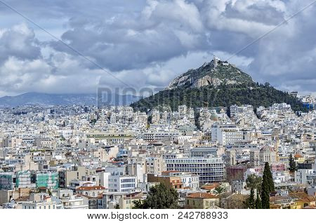 Lycabettus, Is A Cretaceous Limestone Hill In Athens, Greece. Pine Trees Cover Its Base, And At Its