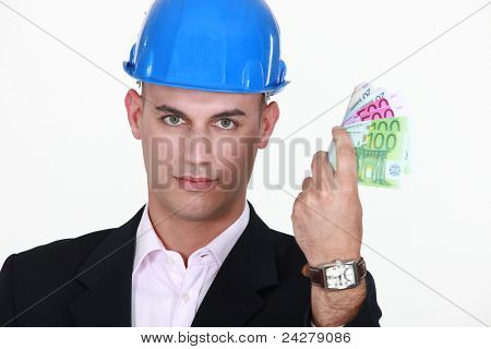 A male architect with his hand full of cash.