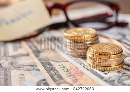 Closeup Of Coins On Banknotes. Pension Planning