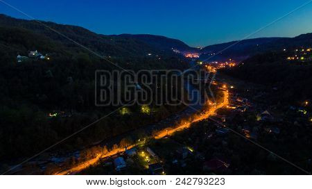 Drone View Of Mountains And Illuminated Road In The Plastunka Village In The Valley Of The Sochi Riv