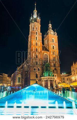The Central Square Of Krakow At Night, View Of The Church Of Mary