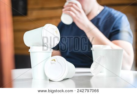 Coffee Or Caffeine Addiction Concept. Addicted Or Thirsty Man Drinking Too Much. Addict With Many Em