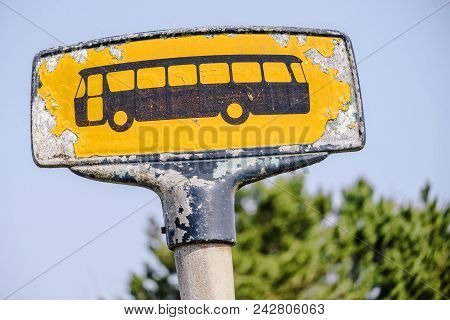 Yellow Bus Stop Sign With A Rough Look In Yellow Colors