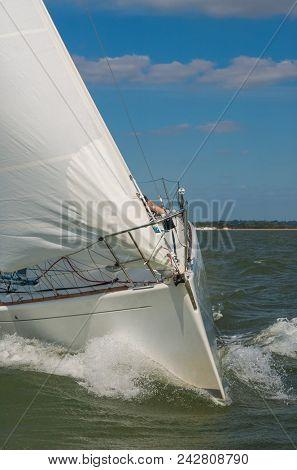 Close up of sailing boat, sail boat or yacht at sea with white sails