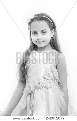 Child Smile In Rosy Dress Isolated On White. Girl With Flower Accessory In Long Blond Hair. Fashion,