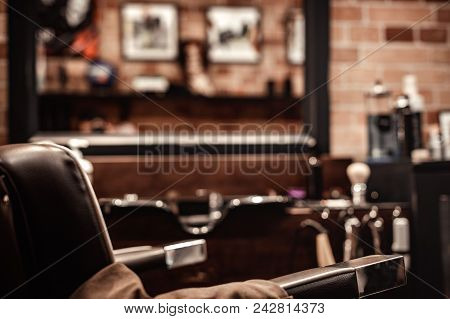 Barbershop Chair And Blurred Background Hairdresser. Barber Shop For Men