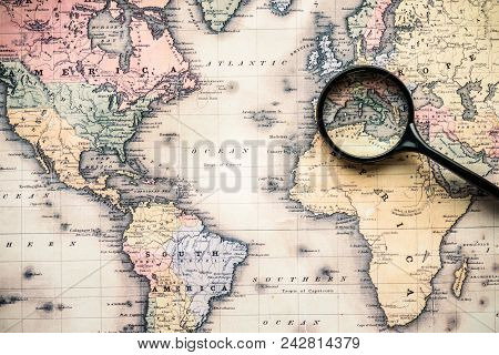 Top View Of Magnifying Glass On Vintage Map Over Mediterranean Sea