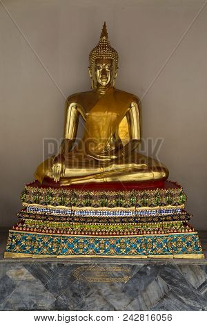 Wat Pho . Temple of the Reclining Buddha. Gilded Buddha statue. Bangkok. Thailand. Famous tourist destination, tourist attraction. poster