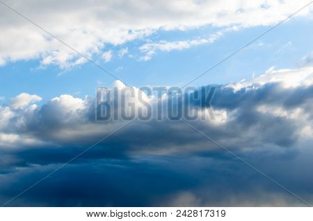Storm Clouds Against A Bright Blue Sky.approaching Storm Front.