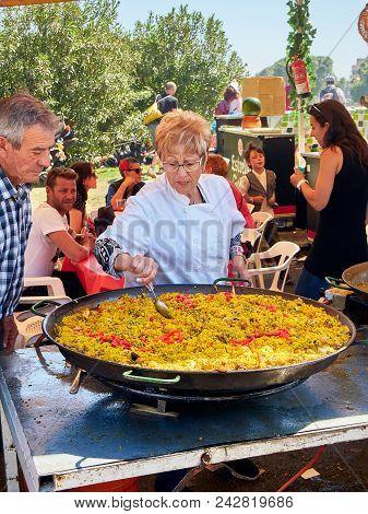 Spanish Paella In Progress At A Gastronomic Fair.