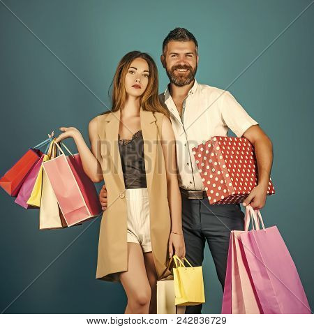 Couple In Love. Shopping And Sale, Happy Couple In Love Of Woman With Long Hair And Bearded Man Hold