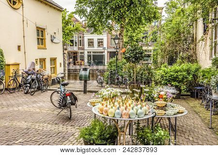 Square In The Center Of Alkmaar With Bicycles And Plants In Alkmaar. Netherlands Holland