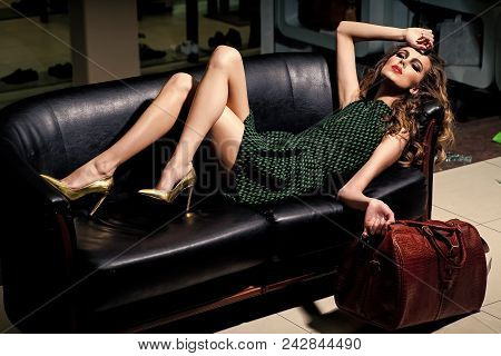 Fashion Model Woman Fece Close Up. Face Woman Wiht Happy Emotion. Sexy Woman Relax On Sofa With Purc