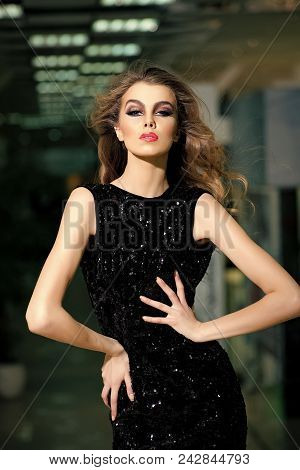 Female Face. Issues Affecting Girls. Portrait Of Beautiful Young Blonde Girl In Black Dress. Fashion