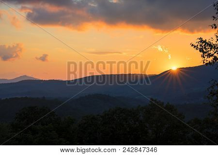 The Sun Sets Behind A Ridge Near Blowing Rock In The Blue Ridge Mountains Of North Carolina.