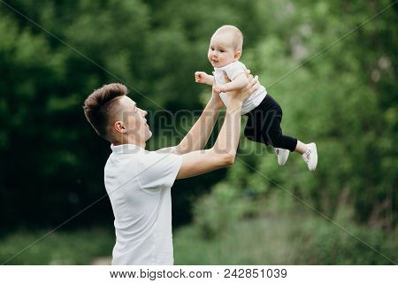 Dad Playing With Little Baby Daughter. Father And Child Walking Outdoors. Childhood, Parenthood, Pat
