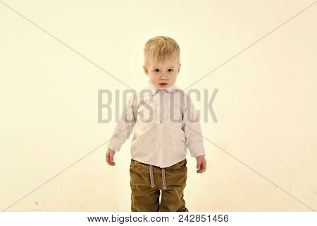 Little Boy In White Shirt, Business. Kid With Blonde Hair, Fashion. Childhood And Happiness, Little