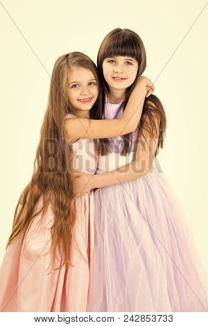 Little Girls Sister With Long Hair Isolated On White. Little Girls Sisters Embrace In Dress Isolated