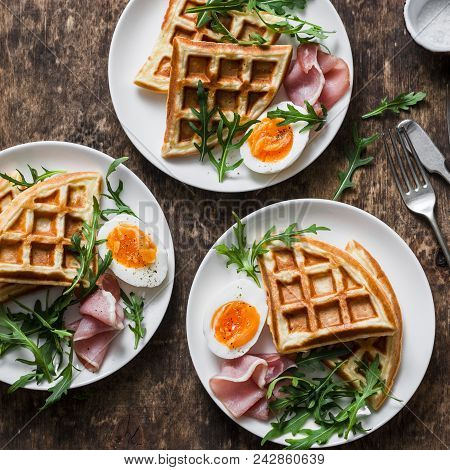 Delicious Savory Breakfast On A Wooden Background - Boiled Eggs, Potato Waffles And Ham, Top View