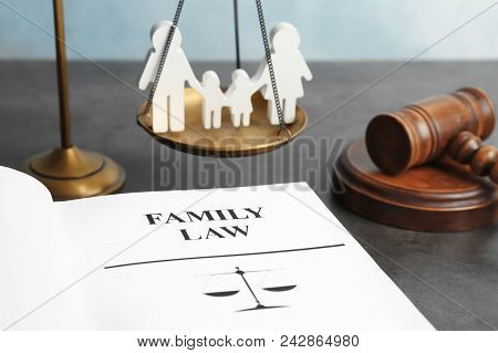 Family Figure, Scales Of Justice, Gavel And Book With Words Family Law On Table, Closeup