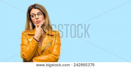 Beautiful young woman doubt expression, confuse and wonder concept, uncertain future