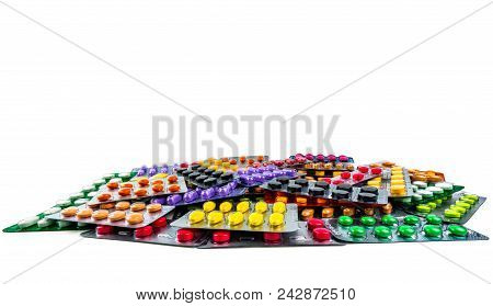 Pile Of Tablet Pills Isolated On White Background. Yellow, Purple, Black, Orange,  Pink , Green Tabl