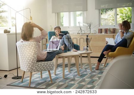 Roommates talking together in living-room