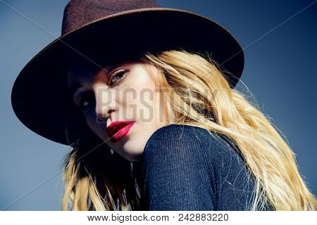 Portrait of a beautiful young woman in hat with blonde long hair. Beauty, fashion concept. Cosmetics and make-up.