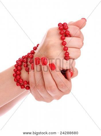 beautiful red manicure and pearls isolated on white