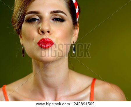 Pin up girl happy and smiling. Pin-up retro female style. Girl pin-up style wearing red dress. Girl sends air kiss for goodbye. Girl is ready to interrupt bored relationship.