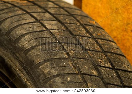 Old car tire tread texture background. Worn out protector of car tire. Used wheels close up poster