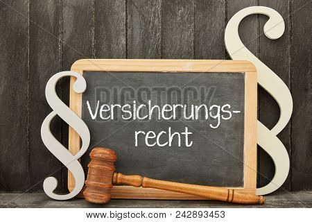 German word Versicherungsrecht (insurance law) as law concept on a blackboard