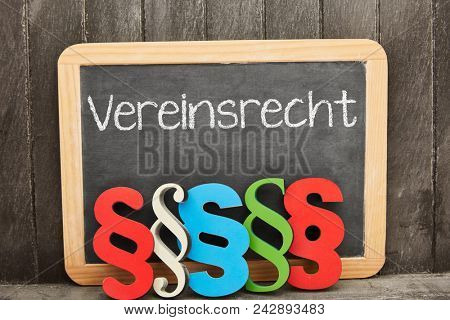 German word Vereinsrecht (club law) as concept with law symbols in front of a blackboard