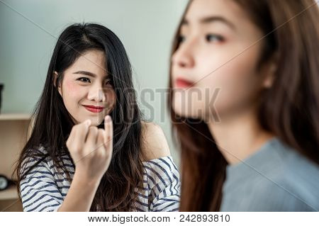 Asian Lesbian Couples Are Touchy Among Themselves. Woman Are To Reconcile Her Lover.