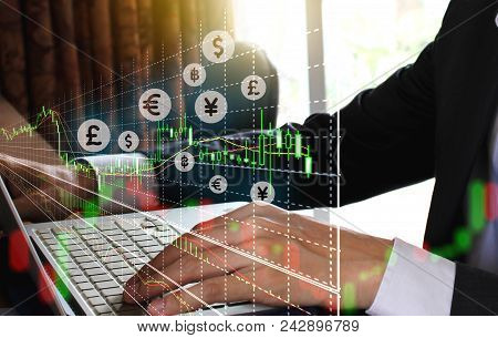 Double Exposure Businessman Using The Laptop And Stock Market Or Forex Graph Suitable For Financial