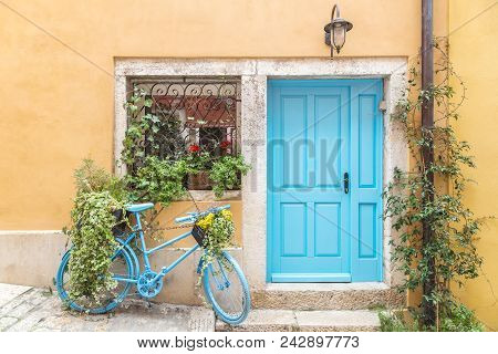 Still Life With Blue Bicycle At Door And Window Of A House In Rovinj, Croatia, Europe.