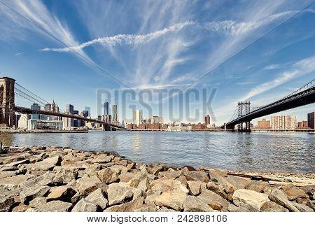 Manhattan skyline view from Brooklyn between Brooklyn Bridge and Manhattan Bridge in New York City