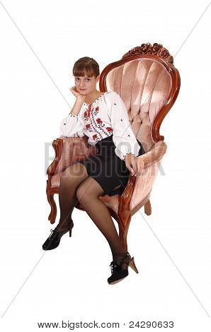 Girl In Pink Armchair.