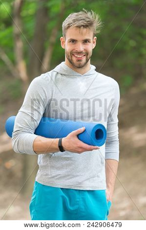 Sportsman Training With Yoga Mat. Time For Yoga Concept. Man Athlete On Happy Face Carries Yoga Mat,