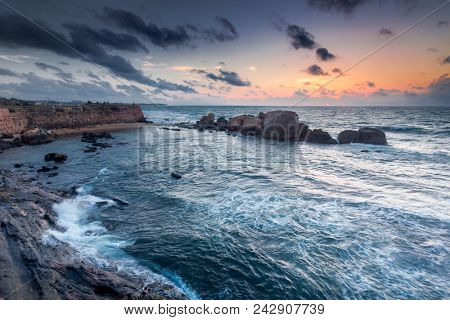 The rocky shores of the Indian Ocean next to Galle, Sri Lanka. The fairy tale seascape in the grey shades. Beauty and strength of wild virgin nature.