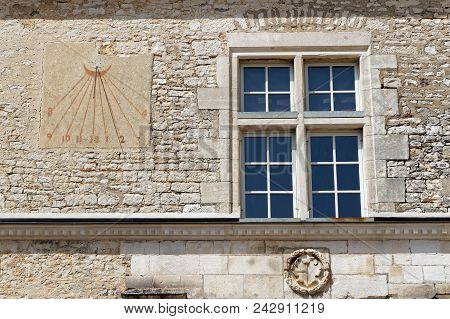 Vougeot, France, May 19, 2018 : Sundial In Chateau Du Clos De Vougeot Courtyard. Clos De Vougeot Is