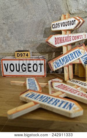 Vougeot, France, May 19, 2018 : Wooden Road Sign Of Main Vineyard Of Burgundy Area.