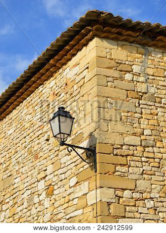 Old Lamppost On A Brick Stone Wall In A Small Village In South France