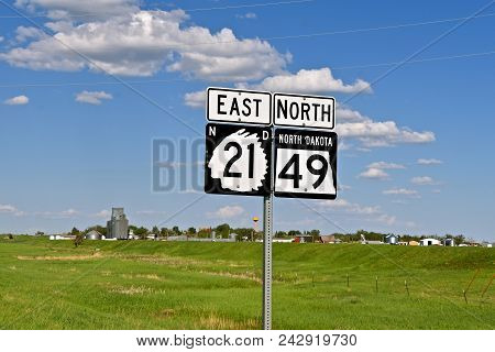 Highway Road Traffic Signs Include North Dakota State Highway Number 21 With An Indian Chief Outline