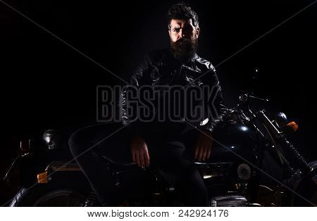 Macho, Brutal Biker In Leather Jacket Stand Near Motorcycle At Night Time, Copy Space. Biker Culture