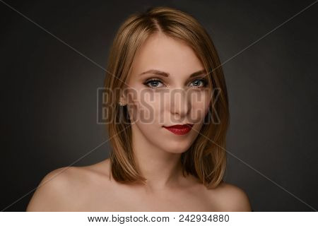 Young Blonde Smiling Blonde Woman Portrait Isolated On Gray Background