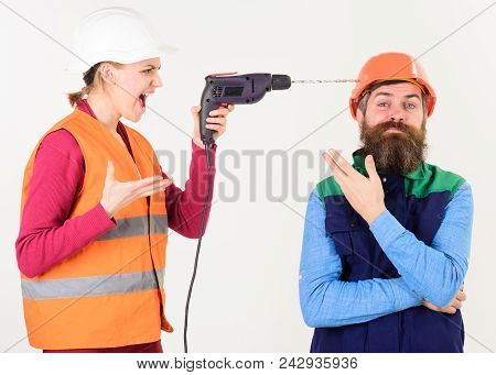 Builder Makes Hole In Male Head. Husband Annoyed By Wife. Carefree And Relaxed Concept. Woman Drills