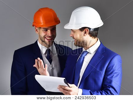 Boss Shows Project To Engineer With Cheerful Face. Engineer And Businessman Discuss Project. Happy E